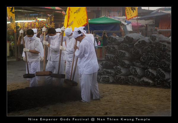 The firewalking ceremony is held on the evening of the ninth day of the festival. As you can see, about 80 sacks of charcoal are used to prepare the firewalking bed, usually measures about 3.5 x 1.2 x 0.6 meters in dimension.