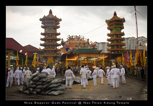 View of the Nan Thien Kwang Temple and the devotees preparing the firewalking bed.