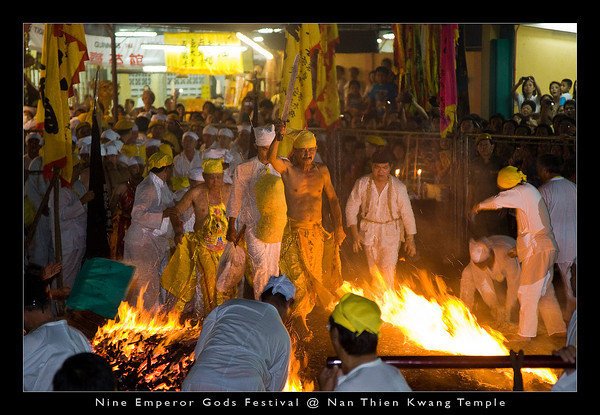 """Once the firewalking bed is prepared, the devotees will start the """"cleansing procession."""" The procession will be led by the entranced spirit mediums."""