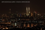 A view of Kuala Lumpur 2 most famous landmarks - KL Tower and Petronas Twin Towers just before 8:30PM, the designated time to unplug and lights-out